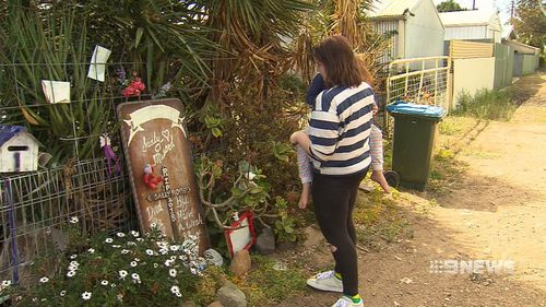 Relatives still lay tributes for the murdered grandmother.