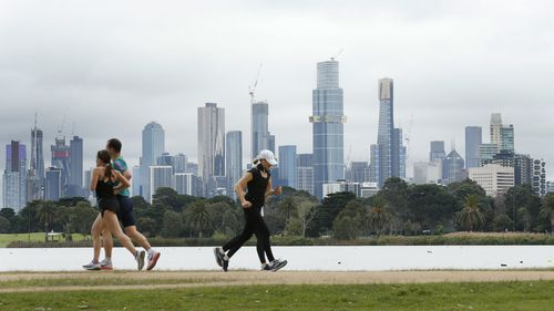 People enjoy their one hour of exercise allowed under stage 4 restrictions at Albert Park on August 16, 2020 in Melbourne, Australia.