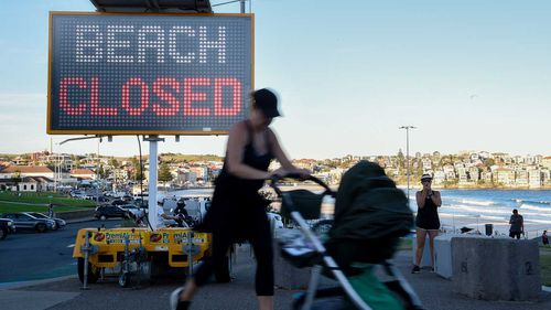A 'beach closed' sign is seen at Bondi Beach in Sydney.