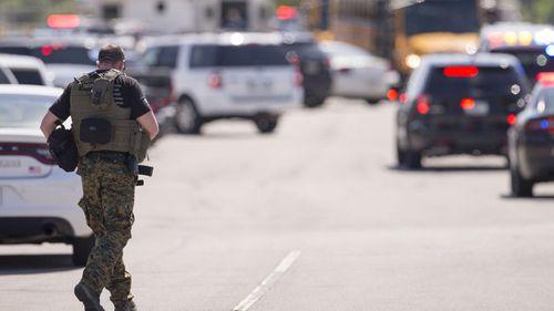A law enforcement officer walks outside Noblesville West Middle School in Noblesville. (AAP)