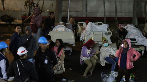 Hospital patients are moved outside of the hospital building after an earthquake was felt in Denpasar, Bali,