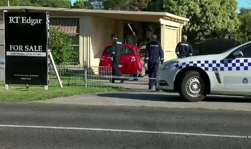 """The residence was on the market, with a """"For Sale"""" sign out the front. (9NEWS)"""