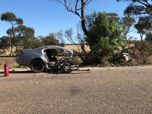The Ford Falcon was ripped in half. (9NEWS)