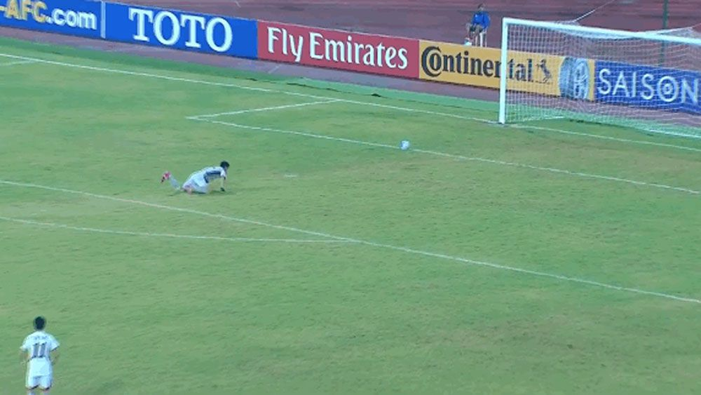Youth goalkeeper pretends to stop shot