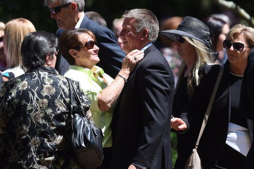 Shayne Goodchild, farther of Dreamworld accident victims Kate Goodchild and Luke Dorsett is consoled during the funeral at St Christopher's Cathedral in Canberra. Picture: AAP