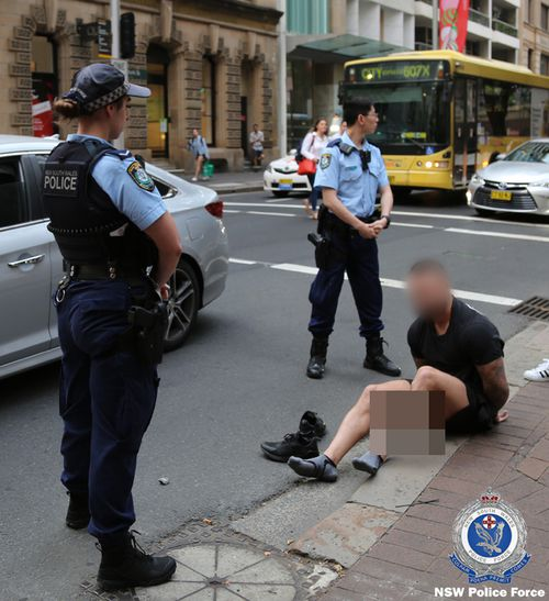 NSW Police arrest a man in the city's CBD.