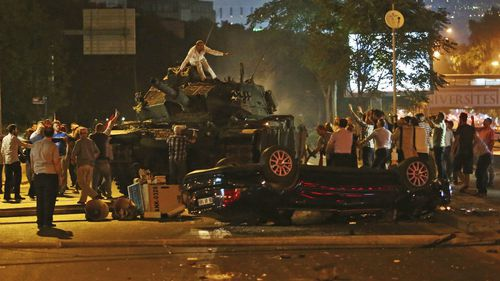 Citizens take the fight back to the military faction behind the coup in Ankara. (AAP)