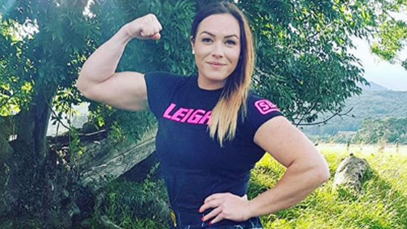 Australian nurse Leigh Holland-Keen becomes first woman in 40 years to lift 332kg 'Dinnie Stones'