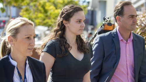 Lead investigator Detective Sergeant Nicola Brown (left) and Dreamworld ride operator Chloe Brix (second from left) are seen leaving the inquest. Picture: AAP
