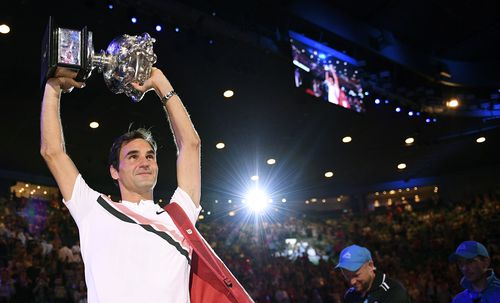 Roger Federer holds the Australian Open trophy aloft for the sixth time after defeating Croatia's Marin Cilic in Melbourne last year.