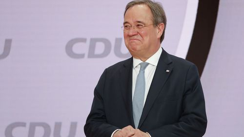 The new elected Christian Democratic Union, CDU, party chairman Armin Laschet stands on the podium after the voting at a digital party convention in Berlin, Germany, Saturday, Jan. 16, 2021