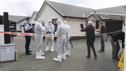 Forensics officers were brought in to examine the property.