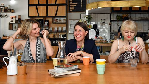 Premier Gladys Berejiklian and sisters Mary (left) and Rita (right) are seen at a cafe during a media opportunity in Willoughby in Sydney on Sunday.