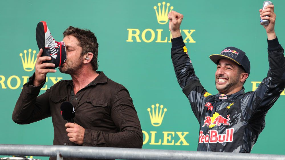 Gerard Butler joins Ricciardo for a 'shoey' after US Grand Prix