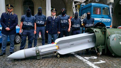 Italian anti-terrorism police seize air-to-air missile, guns in neo-Nazi raids