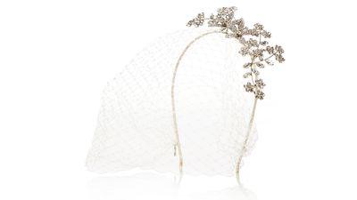 "<p><a href=""http://www.net-a-porter.com/product/542456/Jennifer_Behr/jasmina-violette-veiled-rhodium-plated-swarovski-crystal-headband"" target=""_blank"">Jasmina Violette veiled rhodium-plated Swarovski crystal headband, $1238.30, Jennifer Behr&nbsp;</a></p>"