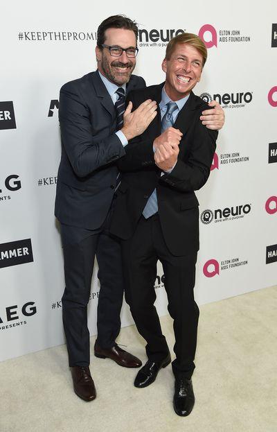 Dapper Mad Men star Jon Hamm and comic Jack McBrayer.