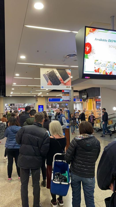 Queues outside an Aldi store in Melbourne ahead of their cookware Special Buys sale in May 2020