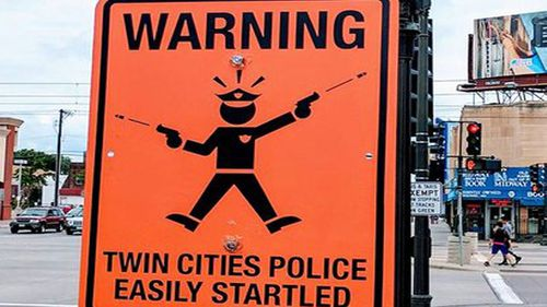 Fake street signs mock Minneapolis police's excuse of being 'startled' prior to Justine Ruszczyk shooting