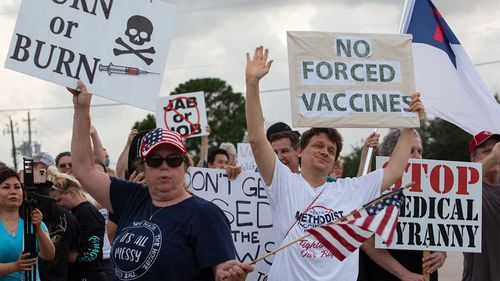 Protesters outside a hospital in Baytown, Texas, which had mandated all staff get vaccinated.
