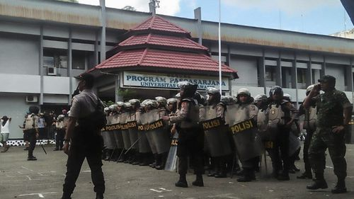 Indonesian police officers stand guard
