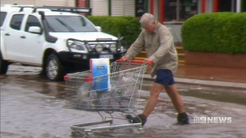 Broome residents stocked up on essential supplies before retreating to their homes. (9NEWS)