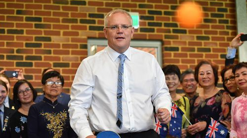 Prime Minister Scott Morrison plays table tennis at a multicultural event at Koondoola, WA.