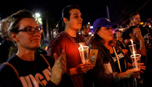 Thousands of people mark two weeks since the mass shooting at a Las Vegas country music festival by walking the Strip in Las Vegas. (AP)