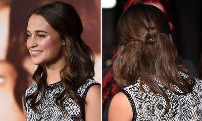 A good one if you've been in salt water. Let hair dry naturally for a wavy texture, then take two sections from the front of the hair and wrap them around to the back. Twist the strands together, where they meet and pin, a la Alicia Vikander.