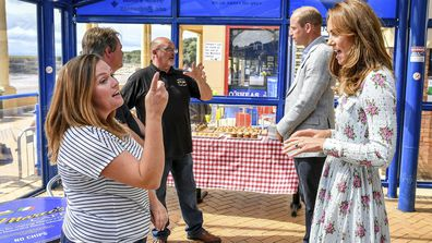 Britain's Prince William and Kate, the Duchess of Cambridge meet with business owners in Barry Island, Wales, Wednesday Aug. 5, 2020, during their visit to speak to local business owners about the impact of COVID-19