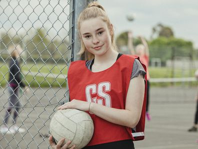 Netballer standing by the court