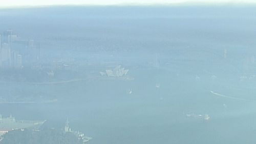 The Sydney Opera House could barely be seen through the haze of smoke. (9NEWS)