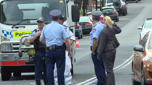 Police today hunted for the other man involved in the altercation on Denison Street. (9NEWS)