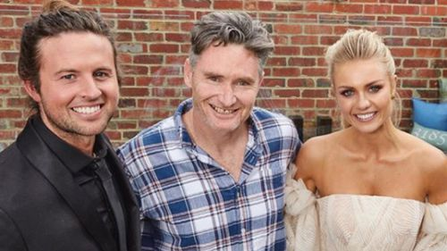 Elyse and Josh with comedian Dave Hughes who bought their home for $3m - to give them a handsome prize of half a million-plus.