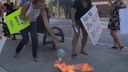 Demonstrators in the US burn face masks in protest against the COVID-19 vaccine.