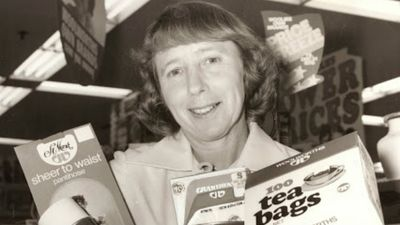 Merle Ockenden holds 'own brand' products at the Sydney Town Hall store in 1976. (Supplied)