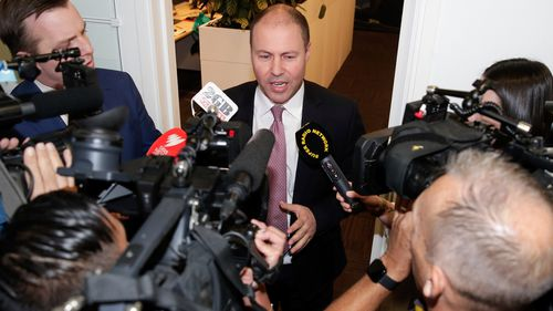 Treasurer Josh Frydenberg addresses the media during a doorstop interview in the press gallery at Parliament House in Canberra