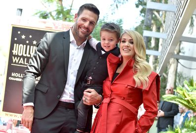 Carrie Underwood with husband Mike Fisher and son Isaiah at the ceremony honoring Carrie Underwood with star on the Hollywood Walk of Fame, September, 2018