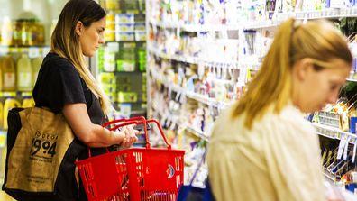 Two women shopping at IGA in Australia.