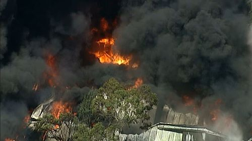 The factory is well alight. (9NEWS Choppercam)