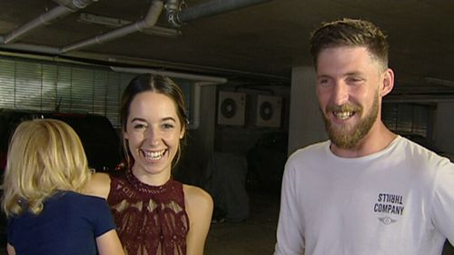 "Gold Coast couple Sarah Brew and Joseph Stephen are all smiles this morning after the ""pretty scary ordeal"". (9NEWS)"