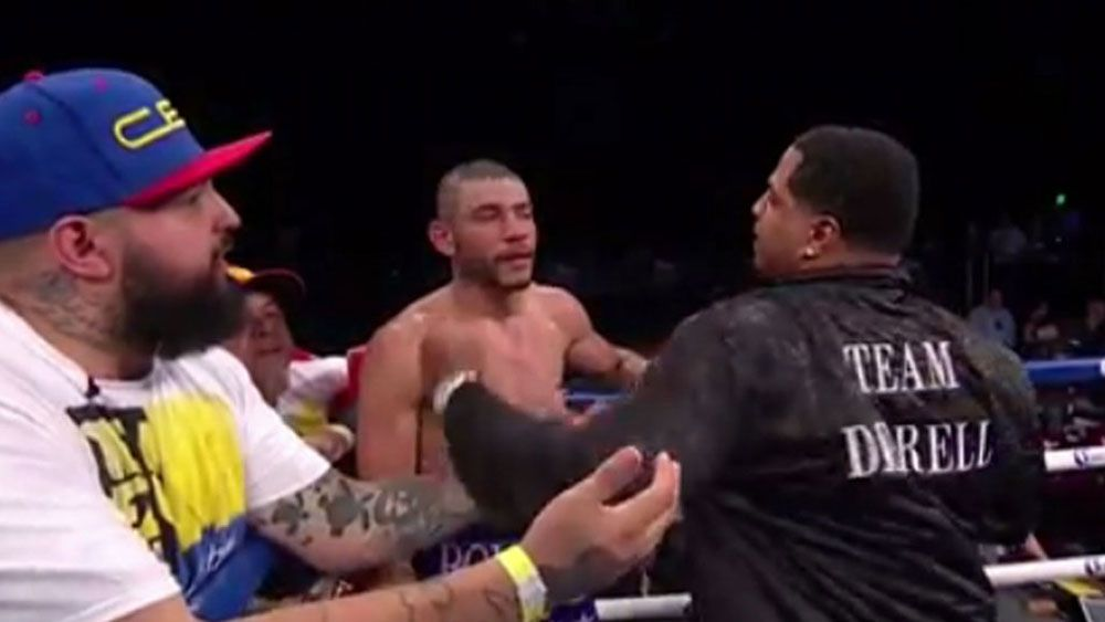 Andre Dirrell's trainer lands coward punch on Venezuelan boxer Jose Uzcategui