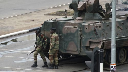 "Armoured personnel carriers were seen outside the capital a day after the army commander Chiwenga threatened to ""step in"" to calm political tensions over the president's firing of his deputy. (AAP)"