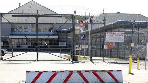 Prisoner charged with inmate's murder
