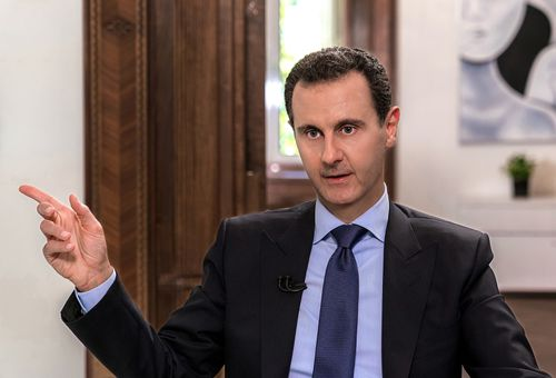 US President Donald Trump says he did not discuss assassinating Syrian leader Bashar al-Assad (pictured), disputing an account in a forthcoming book by journalist Bob Woodward