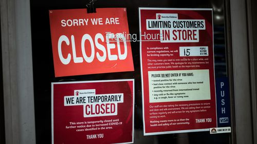 Shops on Sydney Road in Brunswick display signs informing customers of their closure on August 05, 2020 in Melbourne, Australia.