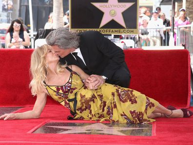 Goldie Hawn and Kurt Russell celebrate their stars on the Hollywood Walk of Fame.