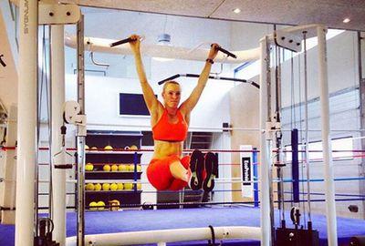 Danish tennis star Caroline Wozniacki sweats it out in the gym.