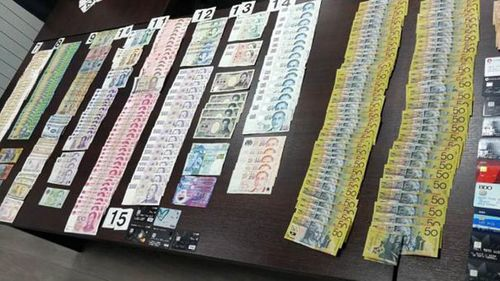 Hundreds of thousands of dollars in cash was seized when the men were arrested.