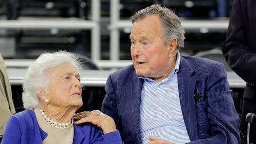 President George H.W. Bush and his wife Barbara Bush speak before a college basketball regional final game in 2015. (AP)